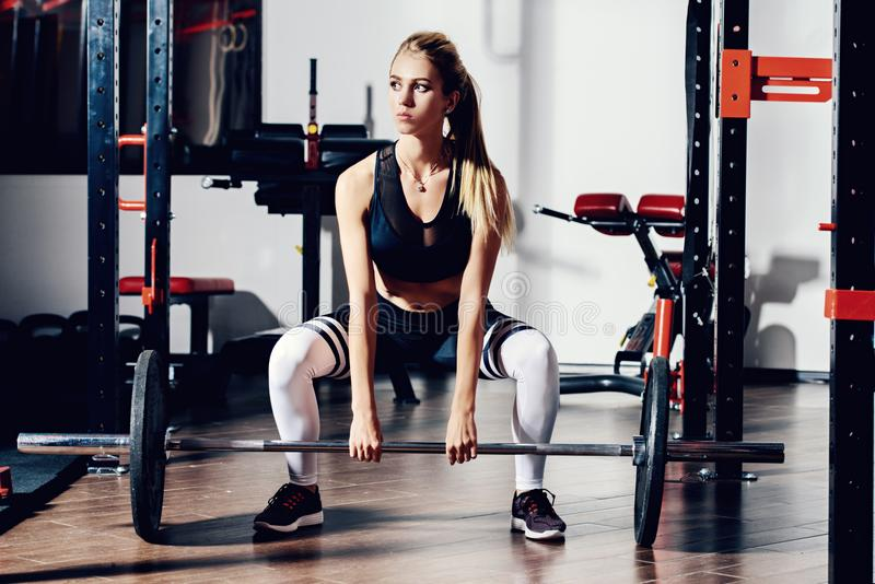 Sit-ups with barbell stock photo