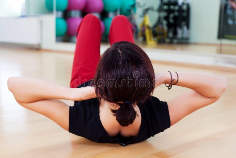 Sit ups. Close up rear view of a woman doing sit ups stock photos