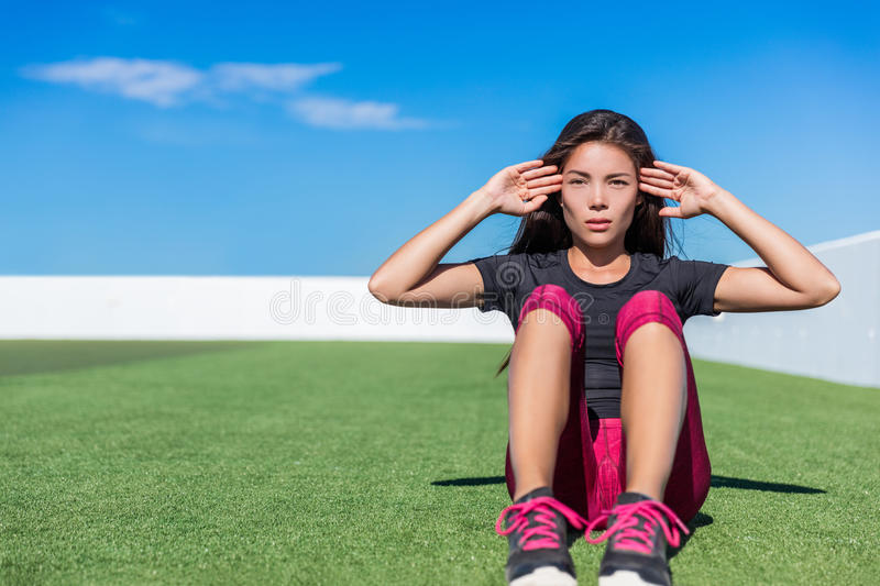 Sit-ups fitness woman doing situp crunches outside. Sit-ups fitness woman doing situps training core abs exercises outside. Fit female sport model girl training royalty free stock photo