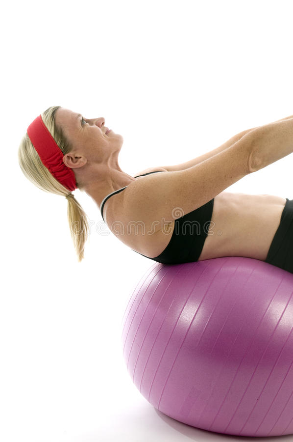 Sit ups middle age woman fitness core ball stock photos