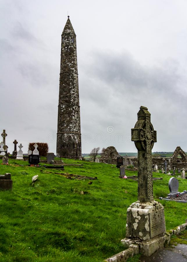 Ardmore Round Tower in Waterford County, Ireland. The site of an early Christian settlement, the Ardmore Round Tower is surrounded by a cemetery royalty free stock images