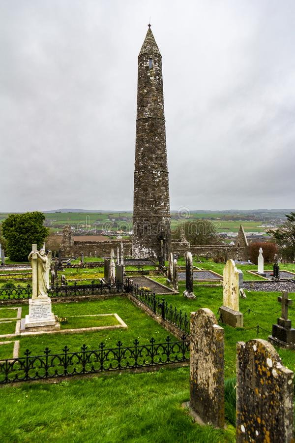 Ardmore Round Tower in Waterford County, Ireland. The site of an early Christian settlement, the Ardmore Round Tower is surrounded by a cemetery stock images