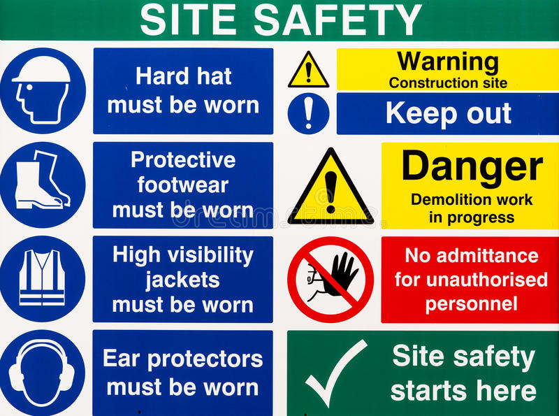 Site Saftey Warning Signs. Brightly colored building site safety warning signs stock photos