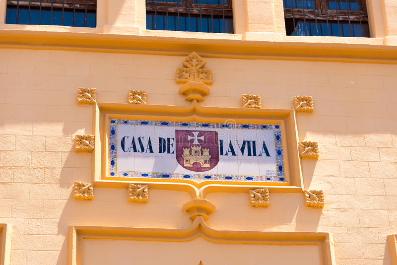 SITGES, CATALUNYA, SPAIN - JUNE 20, 2017: Signboard on the facade of the building. Copy space for text. Close-up. SITGES, CATALUNYA, SPAIN - JUNE 20, 2017 stock image