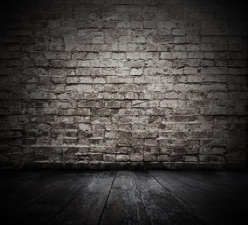 Sitio con la pared de ladrillo foto de archivo