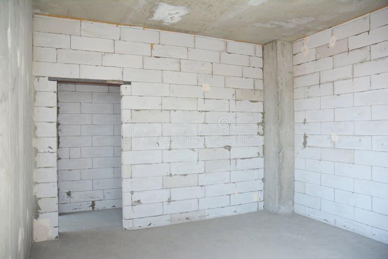 Sitio interior bajo construcción Pared sin plasterwork foto de archivo