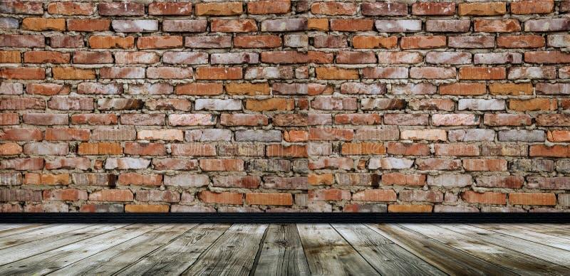 Sitio vacío con la pared de ladrillo roja y el piso de madera imagen de archivo libre de regalías
