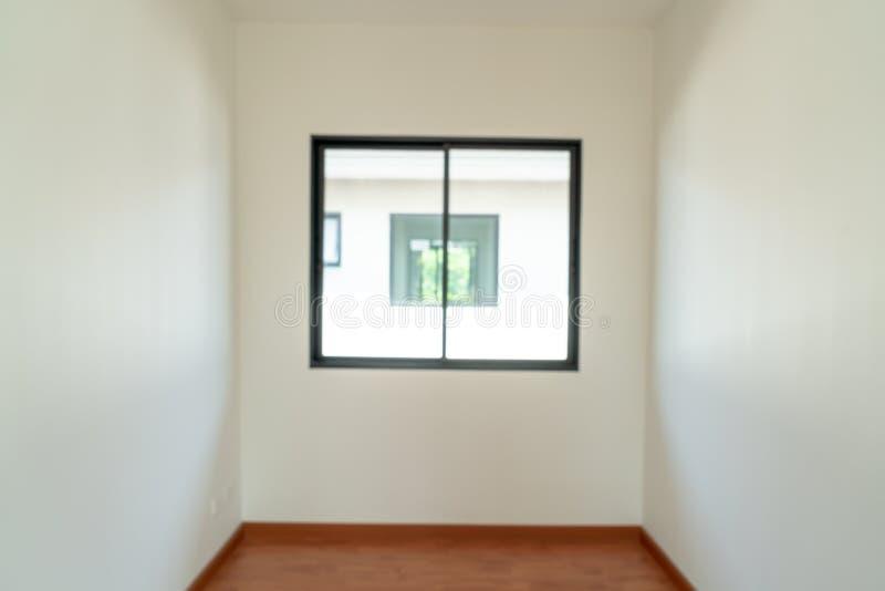 sitio vacío de la falta de definición del extracto con la ventana y puerta en hogar imagen de archivo