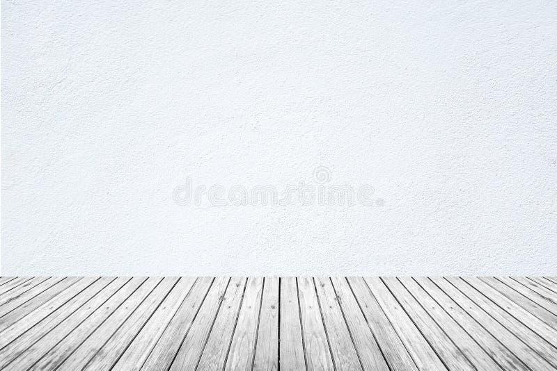 Sitio vacío del piso blanco de la pared y de madera imagen de archivo