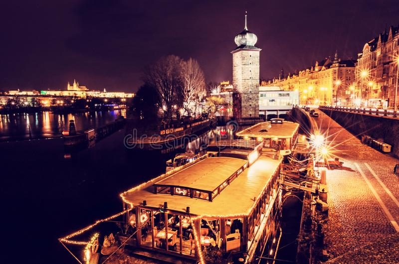 Sitkov water tower and boat restaurant in Prague, Czech republic. Night scene. Travel destination. Red photo filter.  stock photos