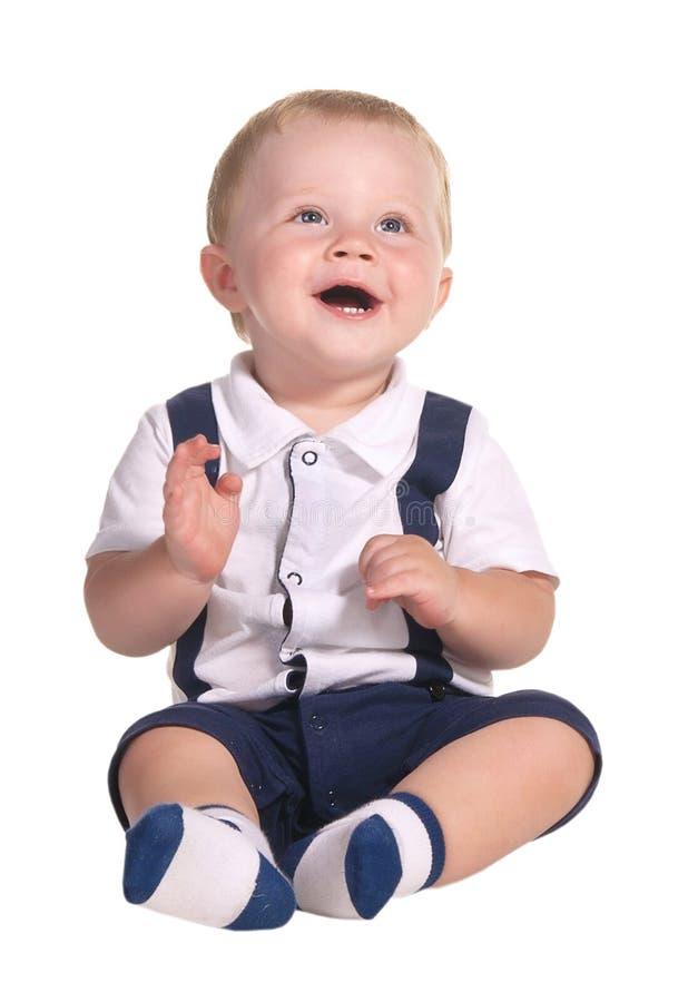 sitta barnvakt leende arkivfoton