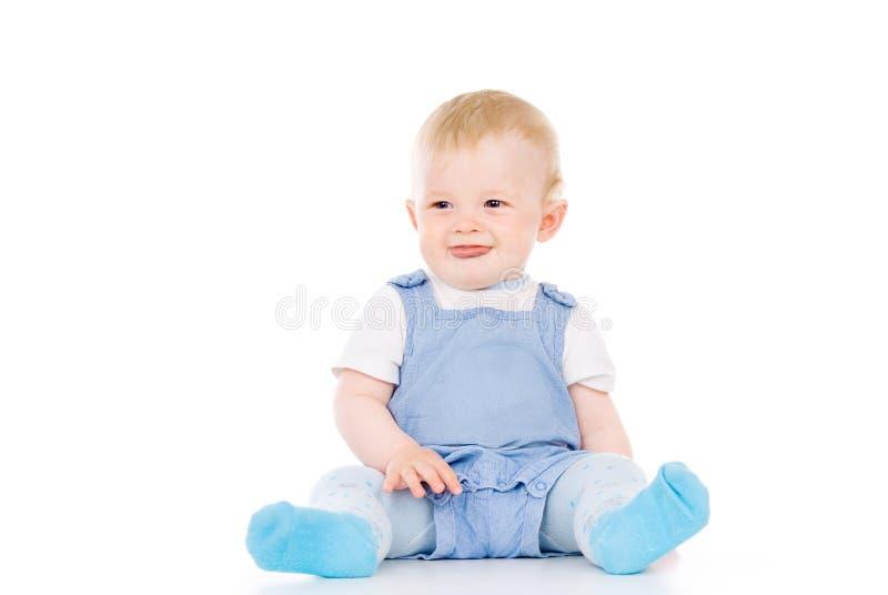 Sitta barnvakt se i riktningen fotografering för bildbyråer