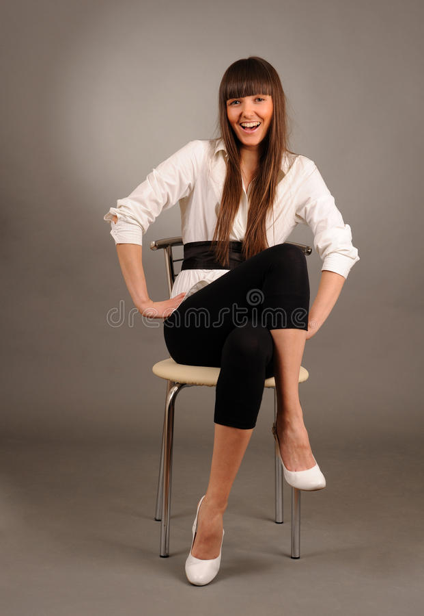 sitta för stol som är swoman royaltyfri bild