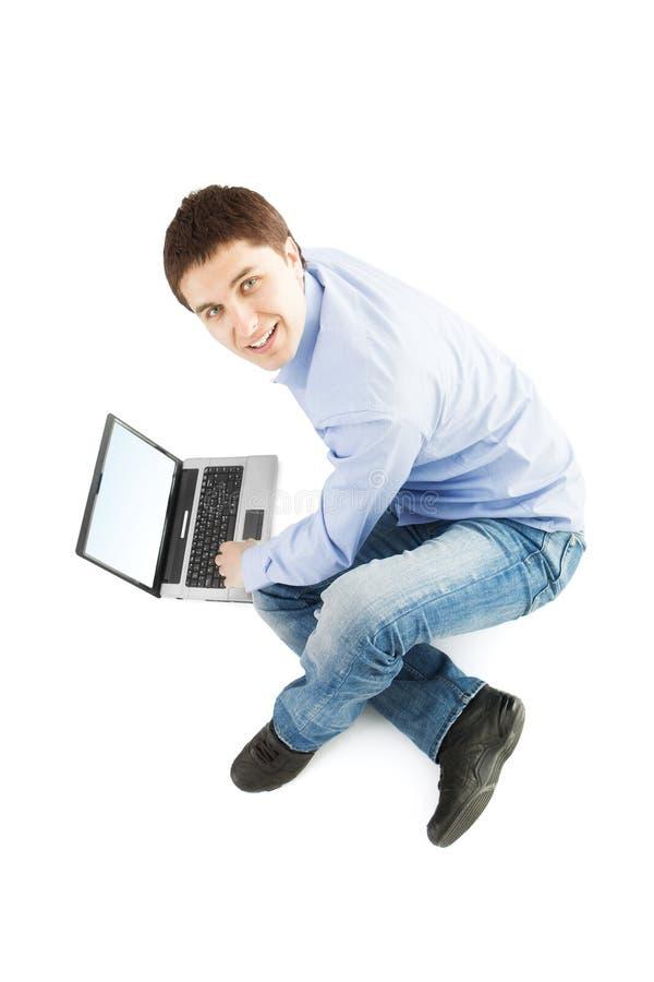 sittande barn för bärbar datorman royaltyfri bild