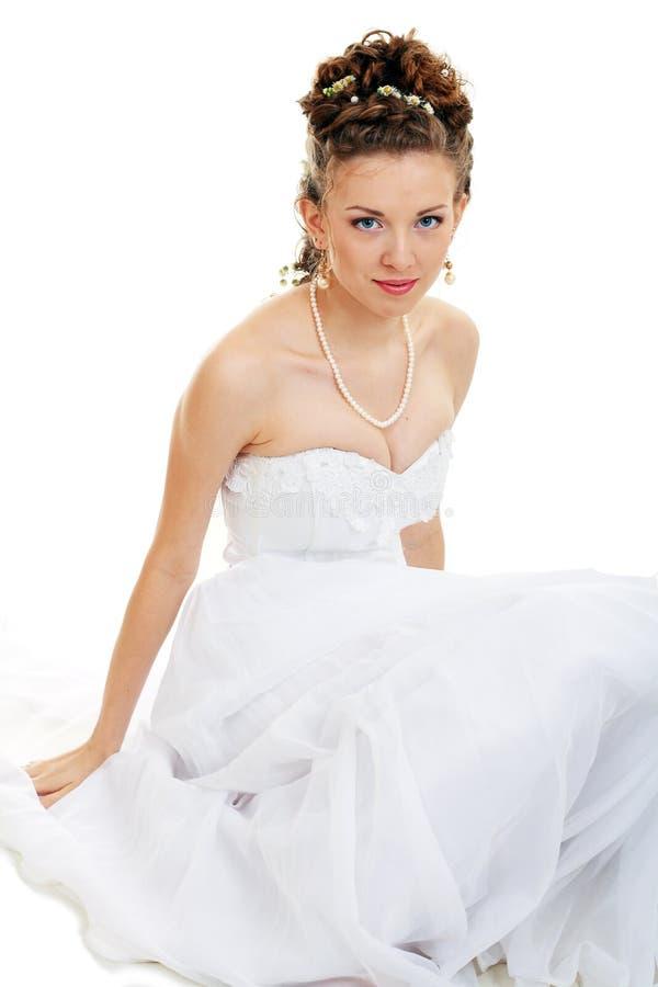 sittande bröllop för brudklänning arkivbilder
