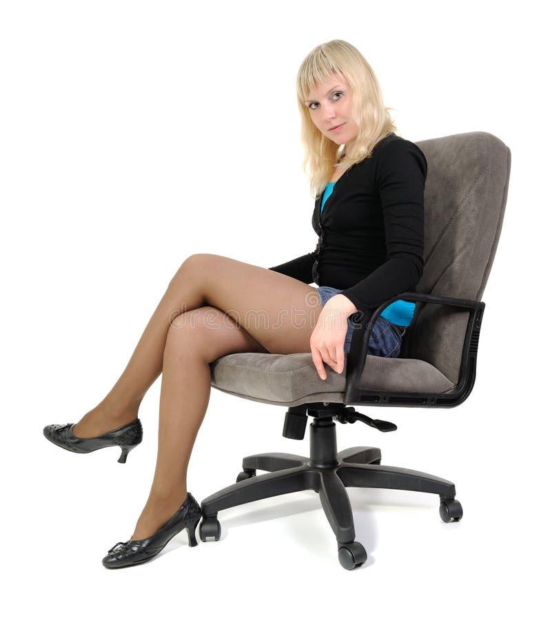 sittande kvinnor för fåtölj arkivbild