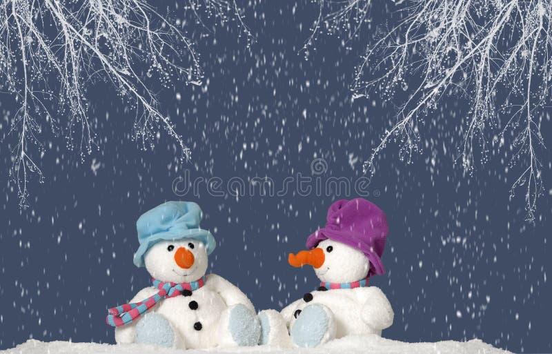 sittande snowman för snow 2 arkivfoton
