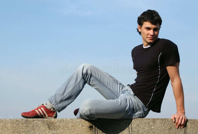 sittande tonåring royaltyfri fotografi