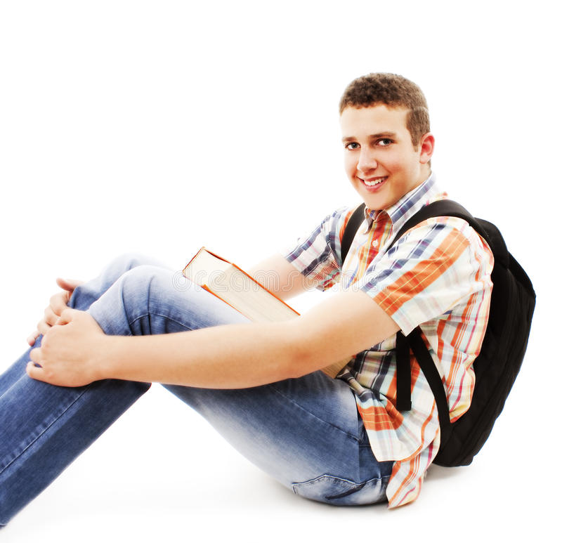 sittande tonåring för bokgolvryggsäck royaltyfri foto