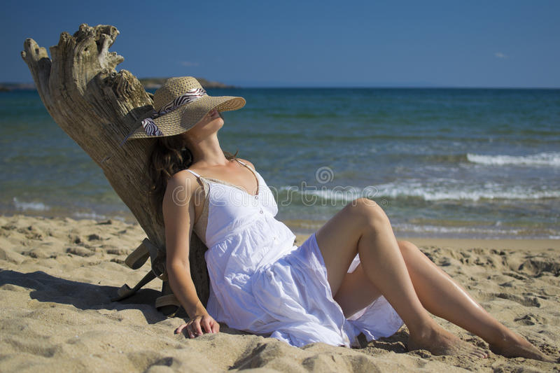 Sitting on the beach royalty free stock images