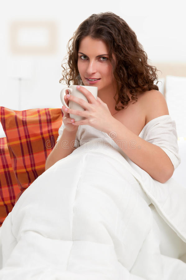 Download Sitting In The Bed And Drinking A Coffee Stock Photography - Image: 30754832