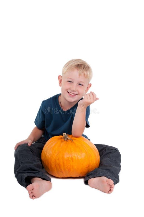 Sitting Boy With Pumpkin Stock Photos