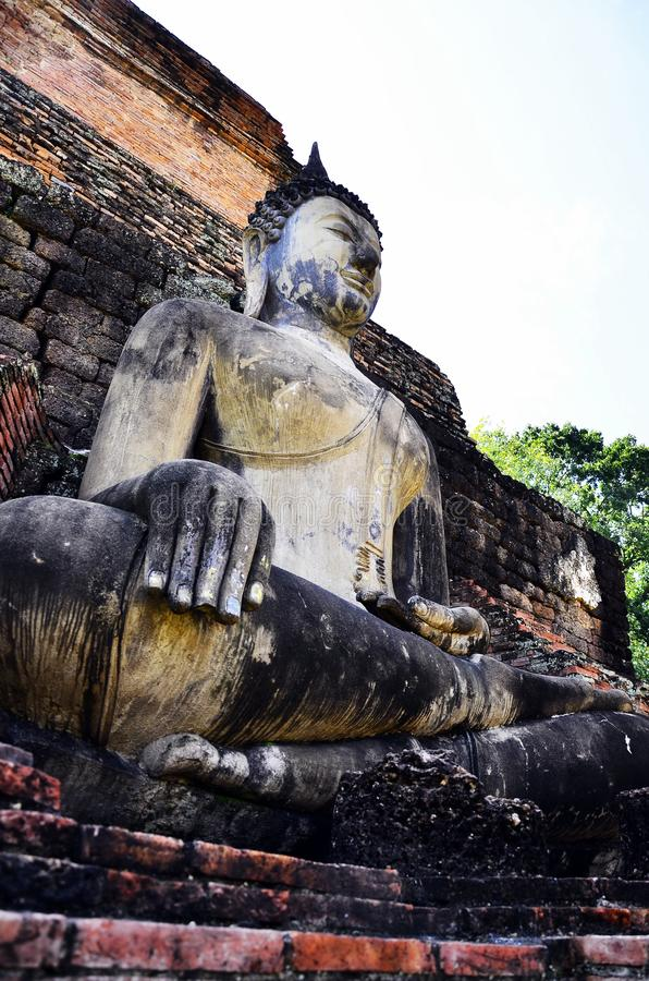 Sitting Buddha image in Assembly Hall in front of the main Stupa at Wat Sa Si ,in front buddha is a prayer royalty free stock image