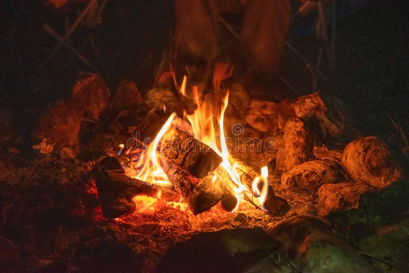 Sitting by the campfire at night stock photo