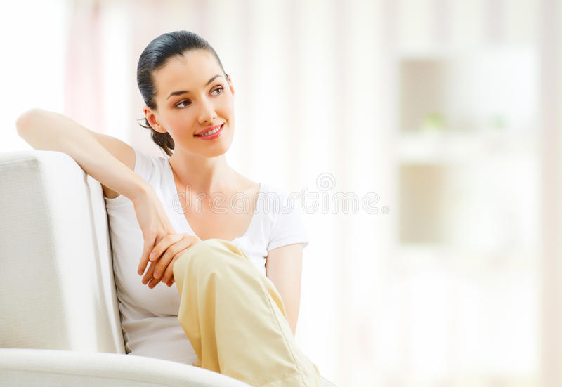 Sitting on a chair royalty free stock image