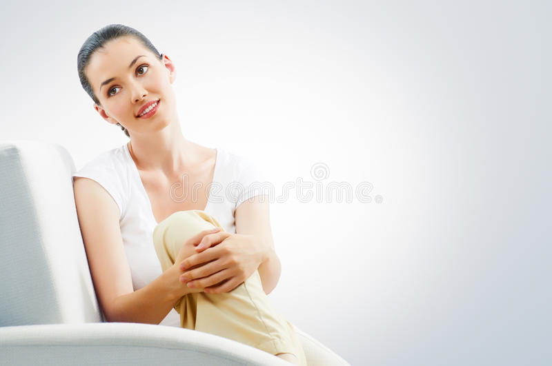 Sitting on a chair royalty free stock photo