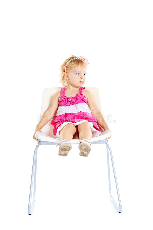 Sitting on chair royalty free stock images