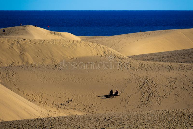 Sitting on the desert dunes in Gran Canaria royalty free stock image