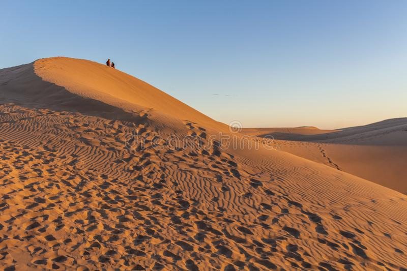 Sitting on the desert dunes in Gran Canaria at sunset royalty free stock image