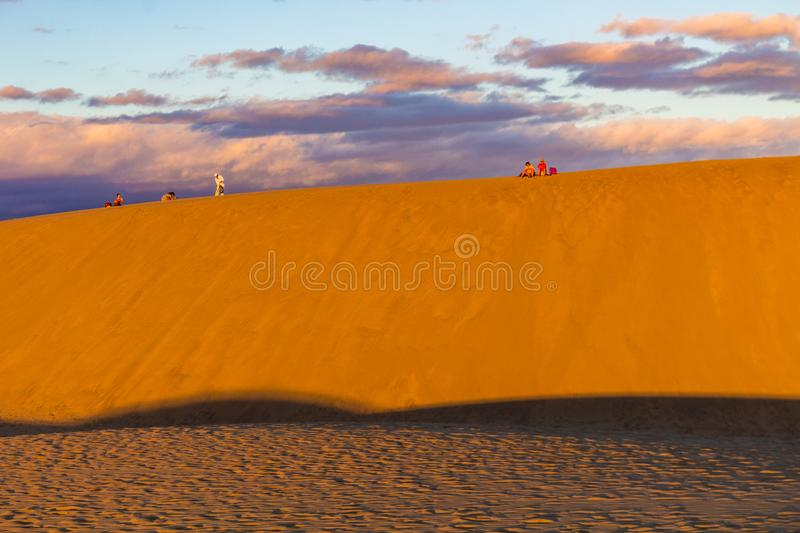 Sitting on the desert dunes in Gran Canaria at sunset royalty free stock photo