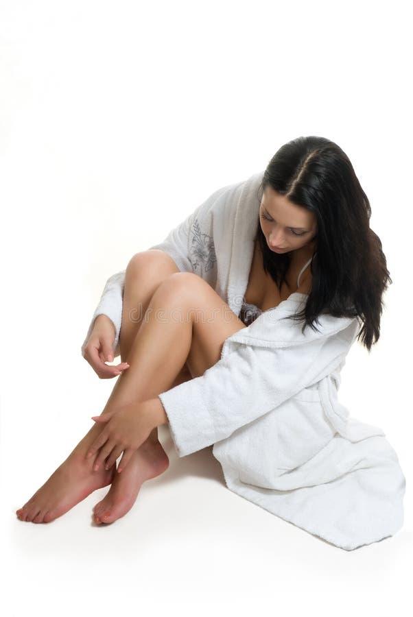 Sitting girl in bathrobe stock images