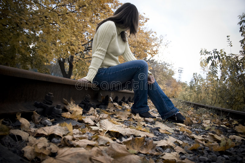 Sitting girl on a tracks