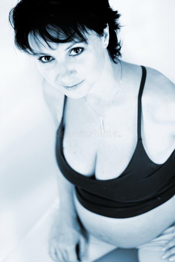 Sitting gravid mother stock photo
