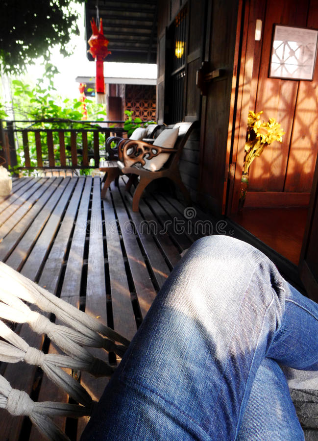 Sitting on hammock, tropical thai resort balcony royalty free stock images
