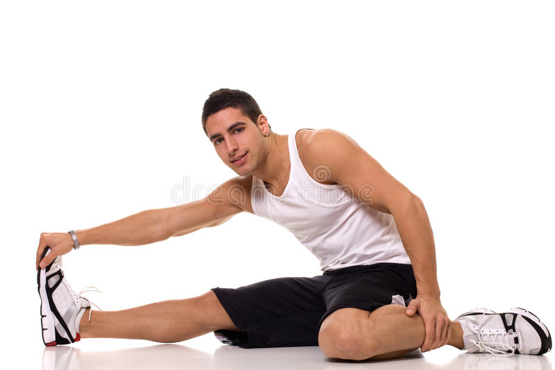 Sitting Hamstring Stretch. Studio shot over white royalty free stock photo