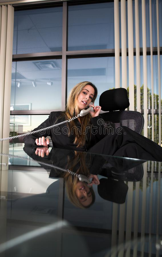 Sitting at her desk royalty free stock image