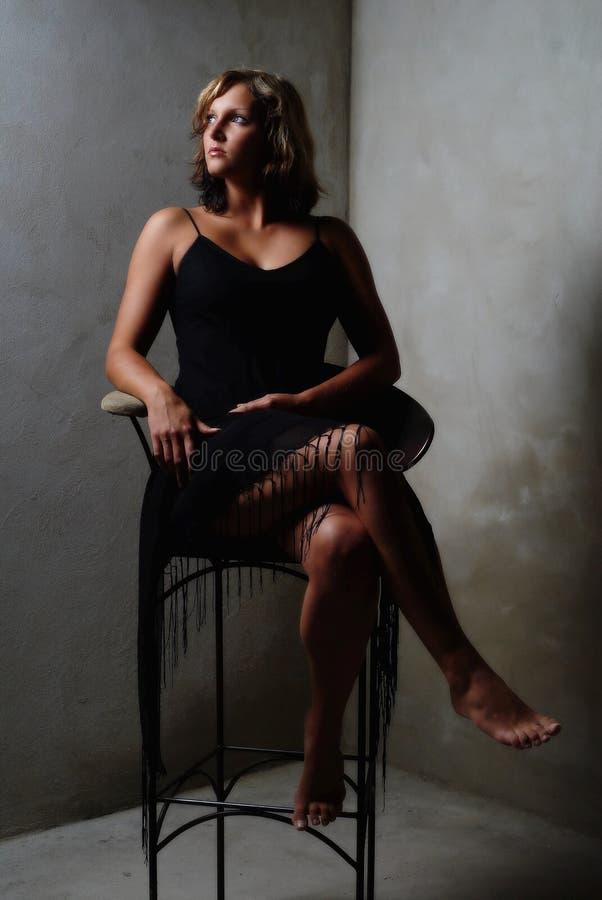 Sitting lady stock photography