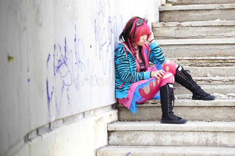 Sitting lolita. Young asian sad girl with cosplay looking stock photos