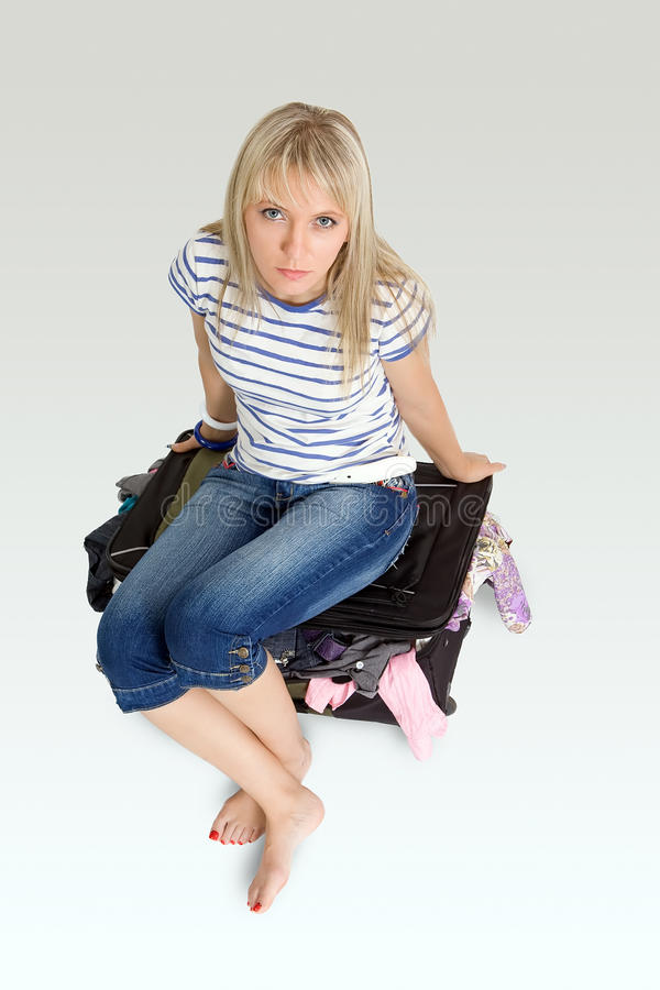 Sitting On Luggage Royalty Free Stock Images
