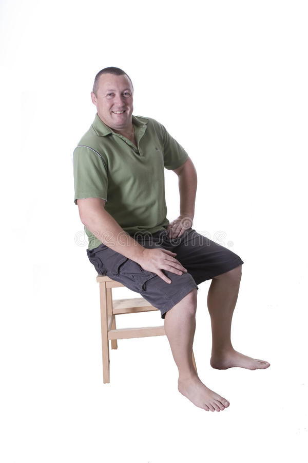 Download Sitting Man In Green Top Royalty Free Stock Images - Image: 15419079