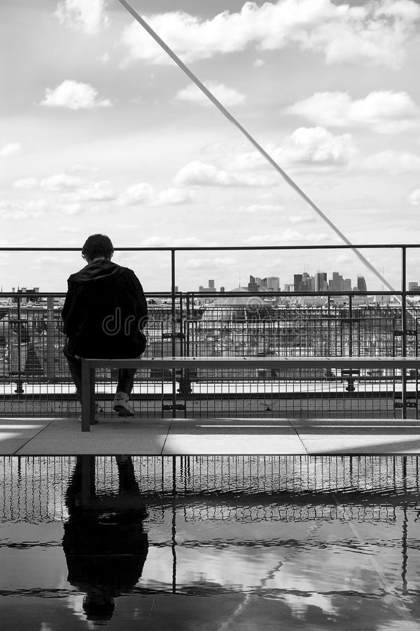 Sitting man and paris skyline. A man sitting with paris skyline background stock photography