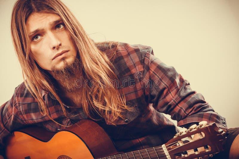 Sitting man playing guitar. royalty free stock photo