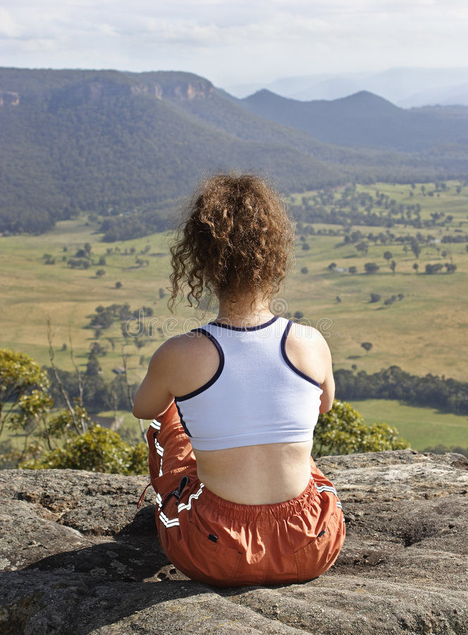 Sitting on the mountain top royalty free stock images
