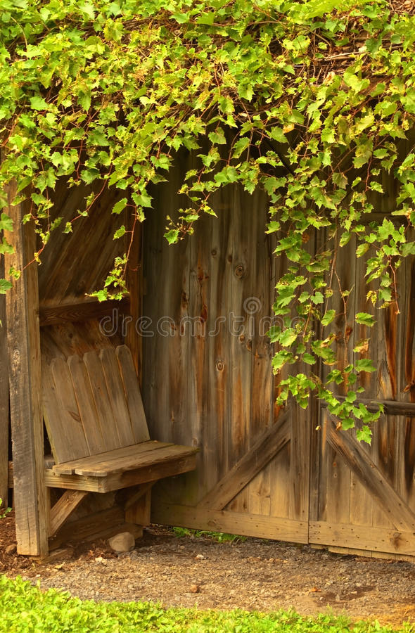Sitting nook. Surrounded by foliage royalty free stock image