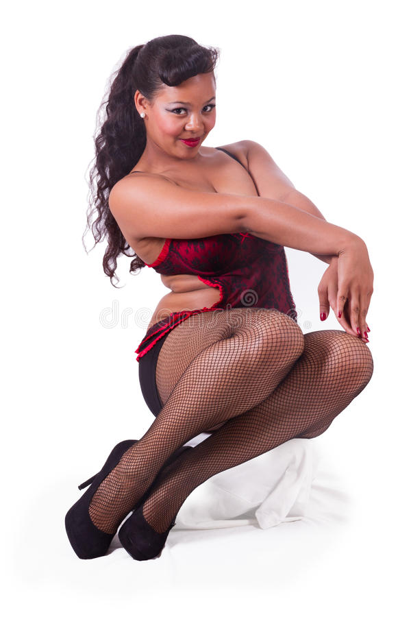Download Sitting Pinup In Red And Black Stock Photo - Image of camera, build: 26405530