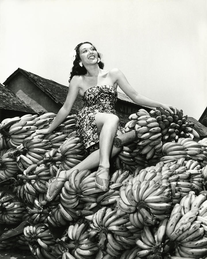 Free Sitting Pretty On A Pile Of Bananas Royalty Free Stock Images - 52034539